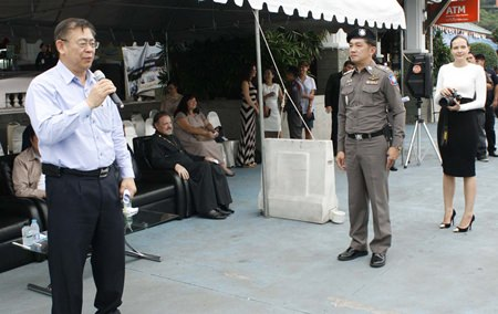 Deputy Prime Minister Yukol Limamthong addresses a gathering of police officials and expats before beginning his inspections of local watercraft.