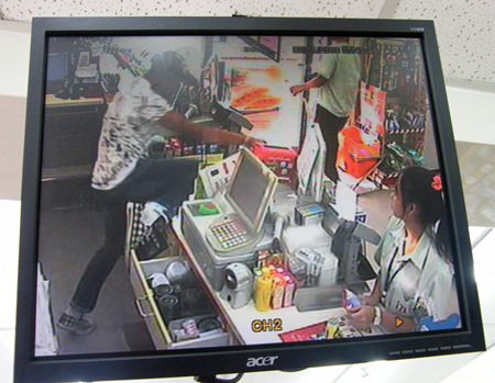 The thief is caught on the store video surveillance camera as he begins his escape.