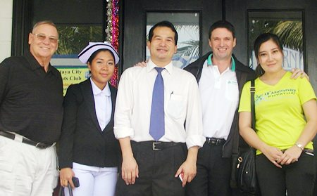 Member Bruce, Dr Mungkorn, Gavin and the Phyathai staff providing much appreciated free blood pressure checks, pose after the meeting.