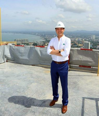 Lionel Lee, Director of Raimon Land, takes in the stunning coastal views from top of Zire's 54-storey tower.