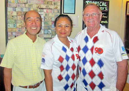 Tuesday's winners, Derek Brook (right) and Mashi Kaneta (left) pose for a photo with Pu.