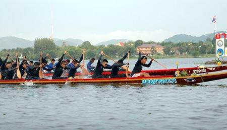 Yuttakanawa and Pornprakaew race for honours in the 55-paddler long boat final.