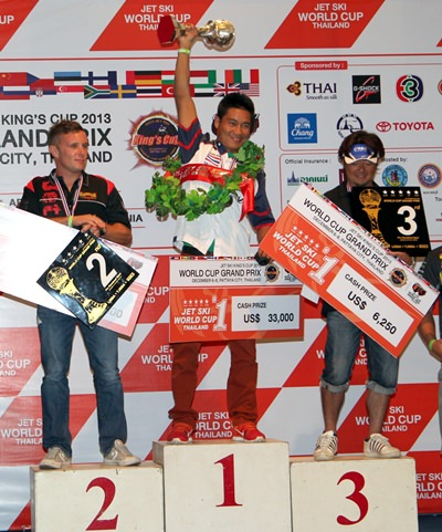 Thailand's Chokutit Molee (centre) holds up the King's Cup trophy after winning the Pro Runabout 1600 class at the 2013 King's Cup Jet-Ski Grand Prix.