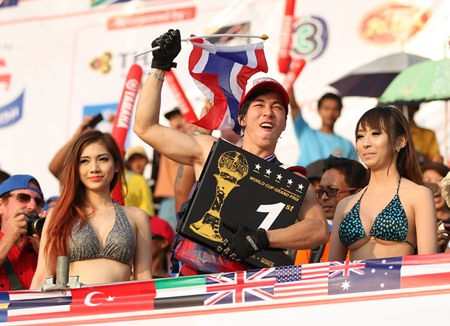 Songwut Lappasappaisan (centre) celebrates after winning a King's Cup for Thailand in the Pro Freestyle event.