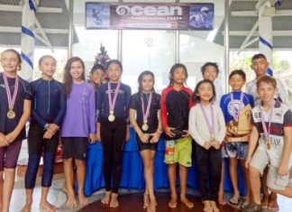 The twelve young sailors pose for a group photo following a weekend's competitive sailing at Royal Varuna Yacht Club, Dec. 14-15.