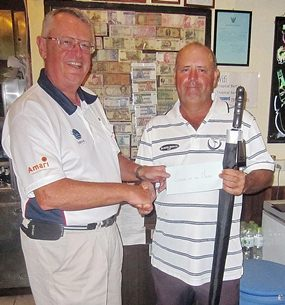 Dick Warberg (left) presents the MBMG Golfer of the Month award to  Bob Watson.