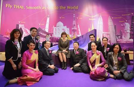 HRH Ubolratana Mahidol (center); Danuj Bunnag (third from right), Executive Vice President Product and Customer Services; Krittaphon Chantalitanon (second left, front row), Vice President Product and Services; Suvadhana Sibunruang (second left, second row), Director Brand Management and Commercial Communications.