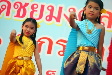 "Young dancers from the Wat Chaimongkol Children's Development Center perform a ""Seenuan"" dance, much to the delight of their parents in the audience.  It was that special time again, when the entire Kingdom celebrated the future: our children. On their very own day, imagination became reality for Eastern Seaboard kids as the area's annual Children's Day celebrations offered opportunities to play fireman, soldier and superhero."