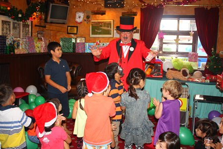 Doc Penguin treats the youngsters to a fun magic show.