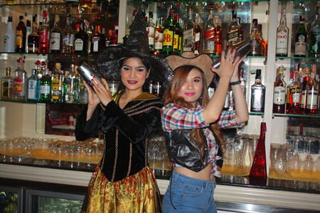 The Witch and Cowgirl serve cocktails at Mata Hari.