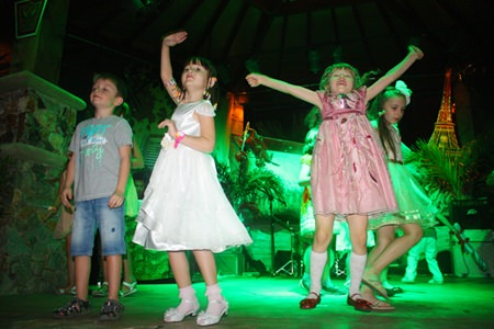 Children dance at the Centara Grand Mirage Beach Resort Pattaya.