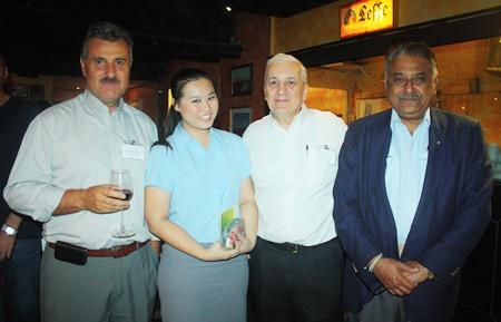 (L to R) Michael Diamente from Dana Spicer, Suratchada Chaivorawat, Corporate Sales Executive for Hilton Pattaya, David R. Nardone, President & CEO of Hemaraj Land and Development PCL and Peter Malhotra, MD of Pattaya Mail Media Group.