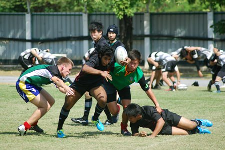 Regents' Rugby Squad shows off their power and determination.