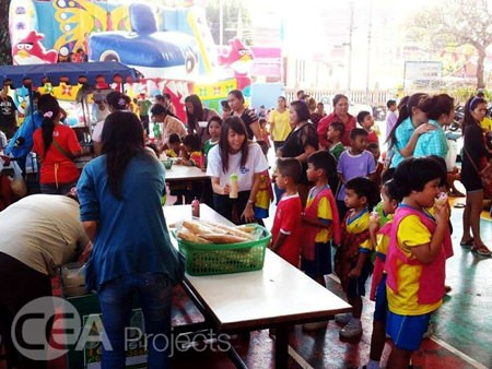 Students line up in an orderly manner to receive their sugary treat.