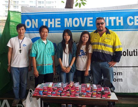 QC Manager Krittapas, Yard Manager David Johnson and staff present educational material to the school.