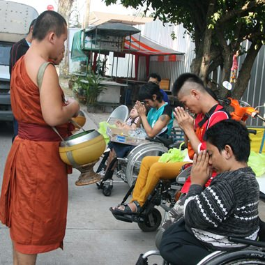 The students received a blessing from the passing monks.