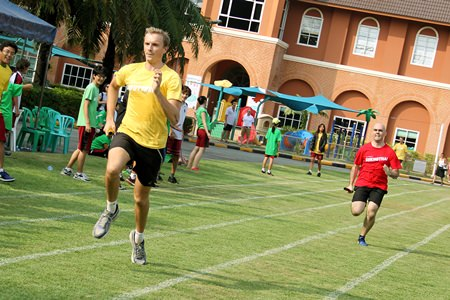 Head of Music Robert Duff is hot on the heels of Head of Maths Andrew Perrins in the Teachers' Relay Race.