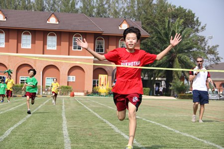 Red House run victoriously through the finish line.