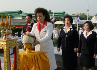 Chonburi Red Cross chief Busarawadee Ekachai lays flower ornaments to pay homage to King Naresuan on Thai Armed Forces Day.