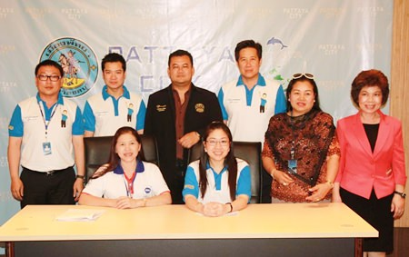Pattaya spokeswoman Yuwathida Jeerapat (seated right) called a press conference to review projects begun by city hall last year.