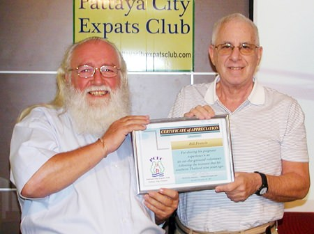 MC Richard presents Bill with a Certificate of Appreciation as thanks for his informative presentation of the drama following the tsunami.
