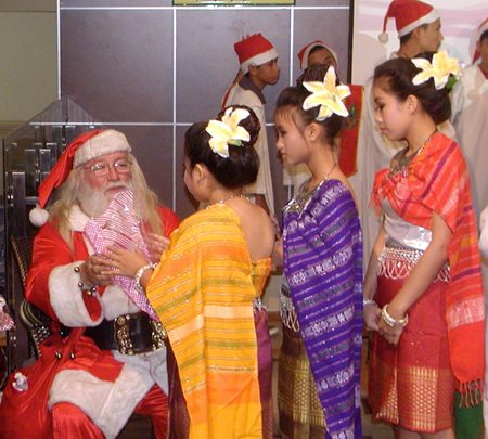 After the carols, Santa gave gifts from PCEC to all the children.