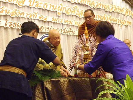 "Sopin Thappajug presents a ""phum ngern"" silver cone containing funds raised for the new Willpower Institute to Luang Pho Viriyang Sirintharo."