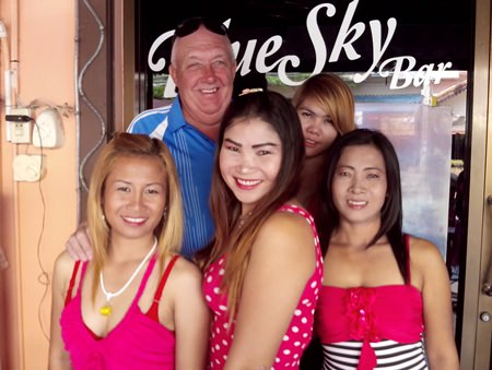 JJ (2nd left) celebrates his win with the staff at Blue Sky Bar.