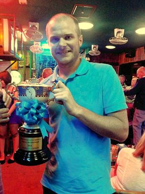 PGS Champion 2014, Chris Smith gets his hands on the trophy at last.