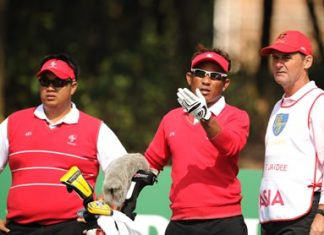 Thongchai Jaidee (center) and Kiradech Aphibarnrat (left) compete at the seventh edition of the Royal Trophy in Guangzhou, China.