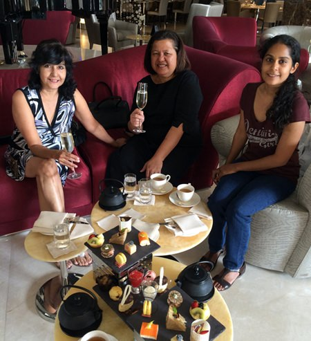 Fine prosecco goes well with high teas as proven by the ladies, Sue of PMTV, Alvi Sinthuvanik and Alisa.