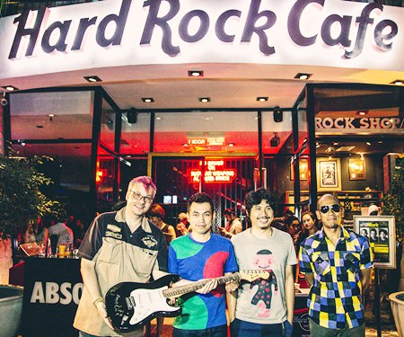 (From left): Mathew Carley, Hard Rock Cafe manager, is presented with the signed guitar from Thanachai Ujjin (Pod Modern Dog), May-T Noijinda and Pavin Suwannacheep.