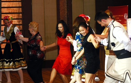 Guests join the folkloric group for an impromptu dance to end the evening.