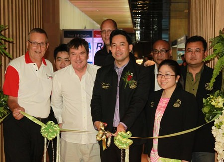 Pattaya mayor Ittipol Khunplome (center right) and Charlie Warner, CEO of Exact Trading Company (center left), preside over the official opening of the 2014 Pattaya Property Show at the Hilton Pattaya hotel, Friday, Jan. 9.