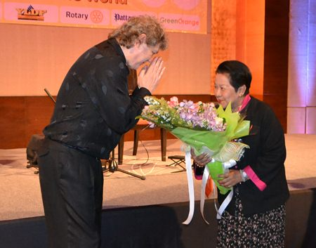 Khunying Busyarat Permsub presents Hucky with a bouquet congratulating him for a most outstanding performance.