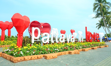"The intersection of Central and Beach Road was decorated in red and white with a ""Pattaya in Love"" banner hoisted so tourists could take photos for Valentine's Day."