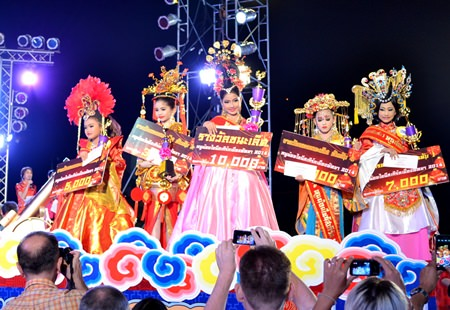Winners and runners-up of the Miss Chinese Girl contest show off the spoils of victory.