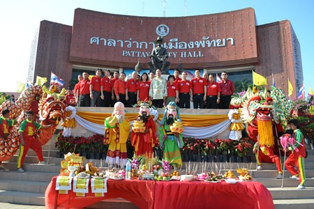 Mayor Itthiphol Kunplome leads city administrators at the beginning of celebrations at city hall.