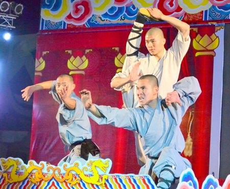 Three Shaolin monks perform a Shaolin Kungfu show.