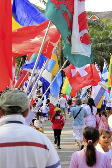 Parents, friends and family join in the International Day parade.