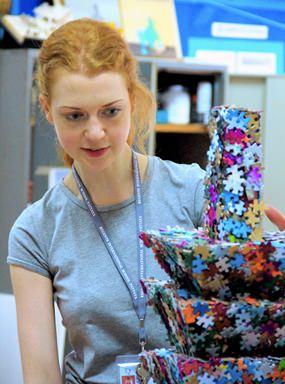 Art teacher Miss Millar admires the jigsaw tower 'Miniature Puzzle Taipei 101'.