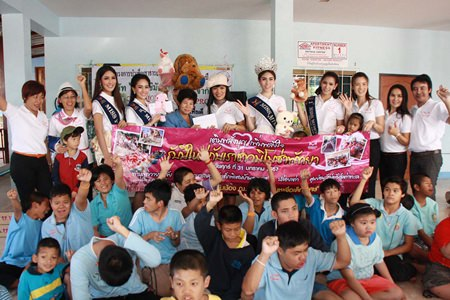 November's Miss Mimosa Queen transvestite beauty pageant winners provided lunch for children at Plutaluang's Ban Khru Boonchu House.