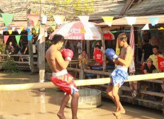"Pugilists get set to begin a ""Muay Talay"" (sea boxing) match at Pattaya Floating Market."