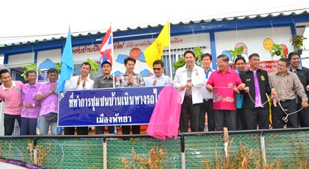 Pattaya officials pull back the curtain to officially open the new center.