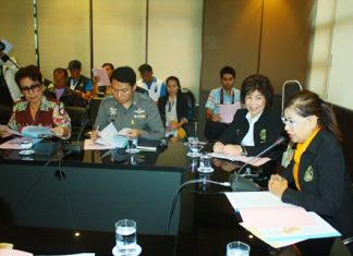 Jintana Maensurin (right), acting director of the Pattaya Education Office, leads a meeting to prepare for April's Songkran celebrations and rice festivals.
