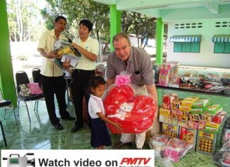General Manager Rene Pisters distributes the gifts.