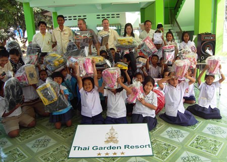 Children cheer the Thai Garden group for the great gifts they received.