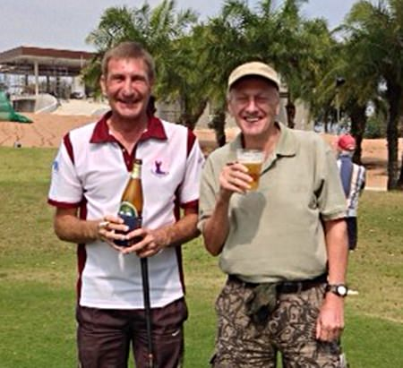 Neil Griffin (right) celebrates a rare win with Skinny Newton on the 1st tee at Greenwood.