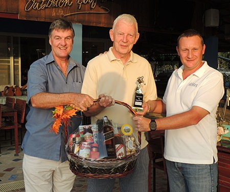 John Stafford (centre) collects the DeVere trophy from Greg Hirst (right) and his Black Label hamper from Pete Stonebridge (left).