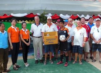 Peter Blackburn distributes the sports equipment